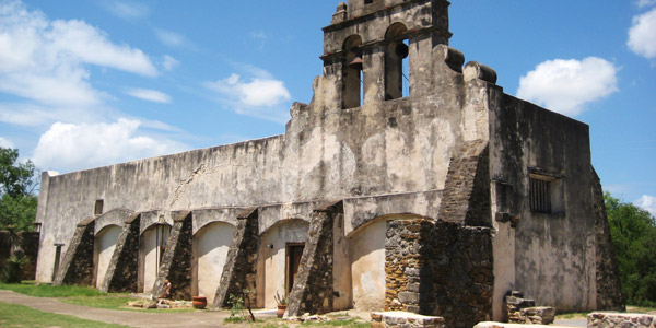 The Remaining Walls Act As Background To Missions Lush Gardens Boasting Adobe Bricks And Tiles Prominent Arches A Bell Tower
